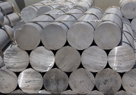 a stack of round steel bars